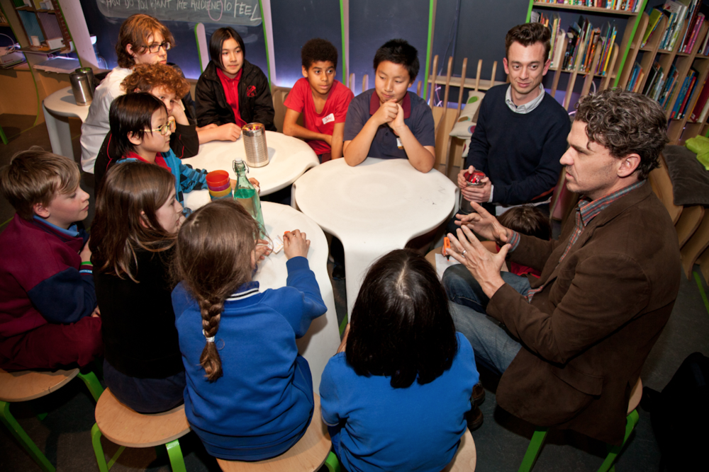 826 Valencia co-founder Dave Eggers with young people at The Martian Embassy